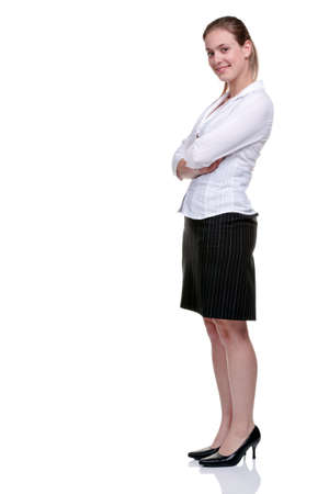 Young blonde businesswoman wearing a pinstriped skirt and white blouse, arms folded. Isolated on white background. photo