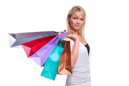 Beautiful blonde woman with shopping bags over her shoulder,isolated on white. photo