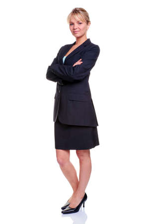 Blonde businesswoman in a suit with her arms folded, isolated on white background.