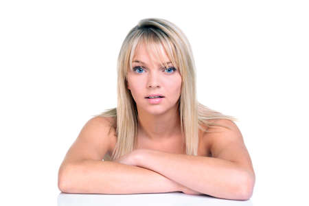 Head and shoulders shot of a beautiful blonde haired young woman, isolated on white background. photo