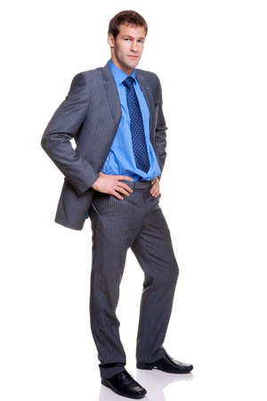 Full length shot of a businessman wearing a grey pinstripe suit, isolated on white background. Stock Photo - 4906157