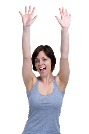 Brunette woman cheering with her hands in the air, isolated on white background. Stock Photo - 4906101