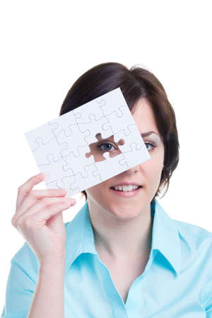 Woman looking through the missing piece of a jigsaw puzzle, isolated on white background. Stock Photo - 4906112