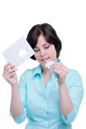 Woman holding the missing piece of a jigsaw puzzle, isolated on white background. Stock Photo - 4906085