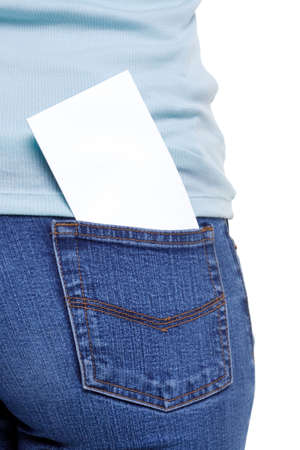 denim jeans: Blank piece of paper in the rear pocket on a females denim jeans, add your own text or image. Stock Photo