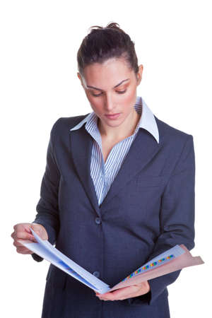 Businesswoman reading some documents in a file, isolated on a white background. Stock Photo - 5034181