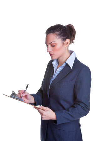 questionaire: Businesswoman writing on a clipboard, isolated on a white background.
