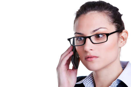 Businesswoman wearing glasses on a mobile phone isolated on a white background Stock Photo - 5034222