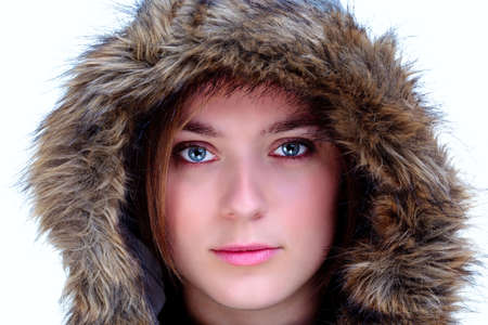 A woman wearing a fur hood looking at camera, isolated on a white background. Stock Photo - 5034183