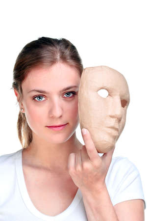 eyes hidden: Young woman holding a mask in front of her face, isolated on a white background.