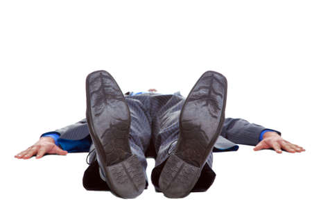 lying down on floor: Businessman in a suit lying flat on his back, isolated on a white background. Stock Photo