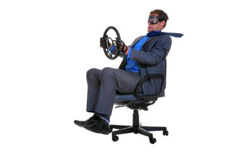 aandrijvingen: Concept beeld van een zakenman rijden langs terwijl zaterdag in een bureaustoel, geïsoleerd op een witte achtergrond. Stockfoto