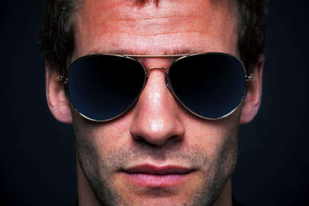 aviator: Close up portrait of a man wearing gold rimmed aviator sunglasses