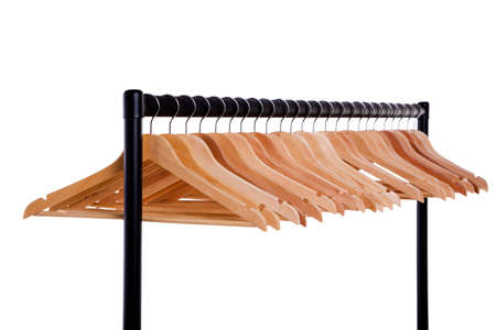 coathangers: Metal clothes rail full of empty wooden coathangers isolated on a white background.