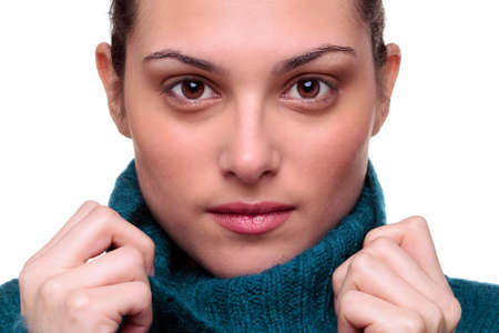A beautiful brunette woman with brown eyes wearing a roll neck sweater looking at camera Stock Photo - 5179506
