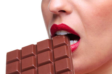 Close up of a woman with red lipstick eating a bar of chocolate, white background. Stock Photo - 5179544