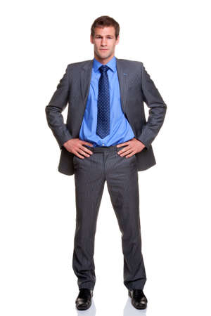 stood: Businessman in a pinstripe suit standing with his hands on his hips, isolated on a white background.