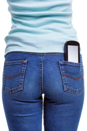 women jeans: A smartphone in the rear pocket of a womans jeans