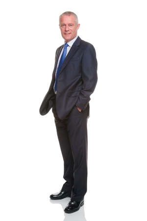 Businessman in suit with his hands in his pockets, isolated on a white background. photo