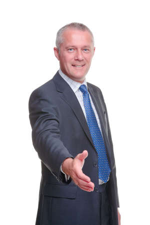 hand out: A mature businessman offering to shake your hand, isolated on a white background.