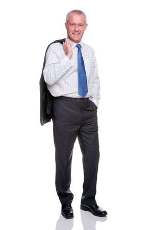 businessman standing: A mature businessman portrait, standing with his jacket over his shoulder looking at camera, isolated on a white background.