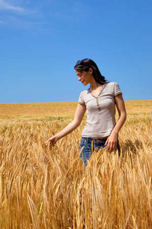 A woman in a field of golden barley  photo