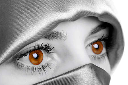 Abstract image of a woman wearing a headscarf which has been digitally enhamced to highlight her eyes, this is the natural colour of the models eyes. photo