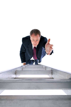 Businessman on a ladder reaching out for help. isolated on a white background. photo