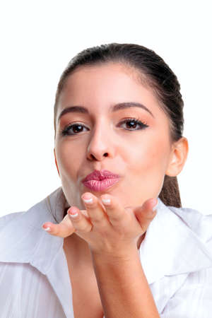 Young woman blowing you a kiss, isolated on a white background. photo