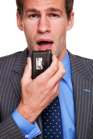 dictating: Empresario de habla en una grabadora de dictado de