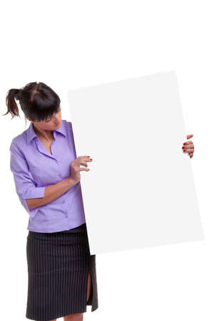 Woman in a shirt and skirt holding a blank sign for you to add your own image or message. Stock Photo - 5662979