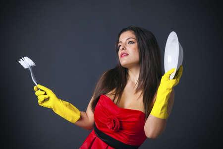estereotipo: Imagen abstracta de un ama de casa todos los glamorosos vestidos hasta los platos.