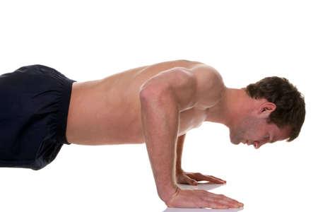 men exercising: Man doing a press, white background. Stock Photo