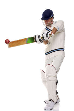 Cricketer playing a shot, studio shot on white background. photo