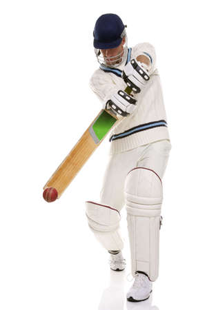 cricket sport: Cricketer playing a shot, studio shot on white background.