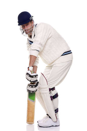 Cricketer getting ready to face the ball, studio shot on white background. Stock Photo