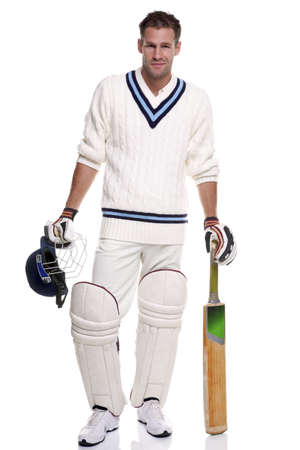 cricket sport: Portrait of a cricket player, studio shot on a white background.
