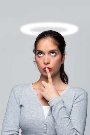 Concept image of a woman who's got a guilty conscience with a halo round her head. Stock Photo - 5840831