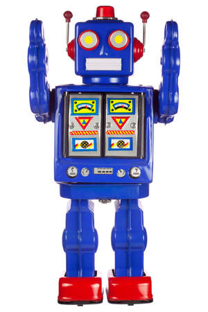 A vintage wind up tin robot with his arms raised, isolated on a white background. photo