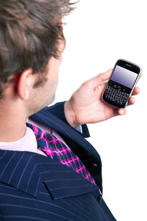 Overhead shot of a man using a mobile phone organiser, screen has a clipping path to add your own message or image. The device has been significantly altered from the original product. Stock Photo - 5840849