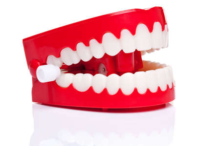 zuby: A pair of joke wind up chattering teeth on a pure white background, high resolution photo.