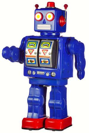 juguetes antiguos: Un muy viejo vintage esta�o robot en una posici�n de pie, aislado en blanco. He limpiado le hasta tanto como sea posible, pero puede haber alg�n terreno roya o damge a su pintura debido a su edad. Foto de archivo