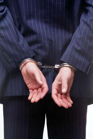 handcuffed: Achteraanzicht van een zaken man in hand boeien  Stockfoto