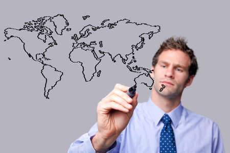 writing on glass: Businessman drawing a map of the world on a glass screen. The background is a uniform color all over so you can increase the copy space easily. Focus is on his hand, pen and sketch.