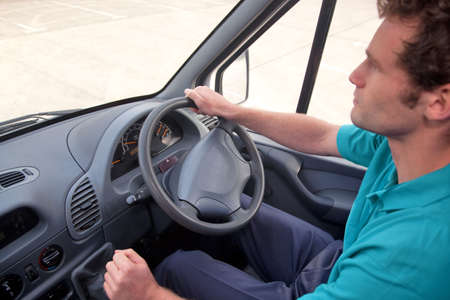 panel van: Van driver in a right hand drive vehicle. Also available as LHD, instrument panel is correct for both images. Stock Photo