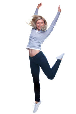 A blond woman jumping in the air, slight motion blur. Isolated on a white background. Stock Photo - 5978766