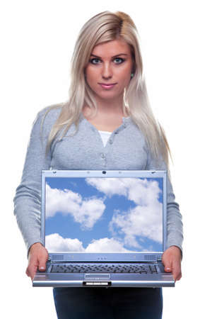 A blonde woman in casual clothing holding a laptop computer towards camera, screen has a clipping path to add your own image or text. Stock Photo - 5955306