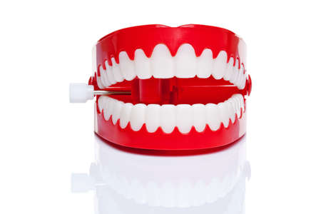wind up: A pair of joke wind up chattering teeth on a pure white background, high resolution photo.