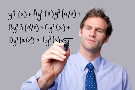 Teacher writing a mathematical equation on a glass screen. The background is a uniform color all over so you can increase the copy space easily. Focus is on his hand and pen. Stock Photo - 6444154