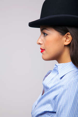 Side view of a businesswoman wearing a bowler hat. photo